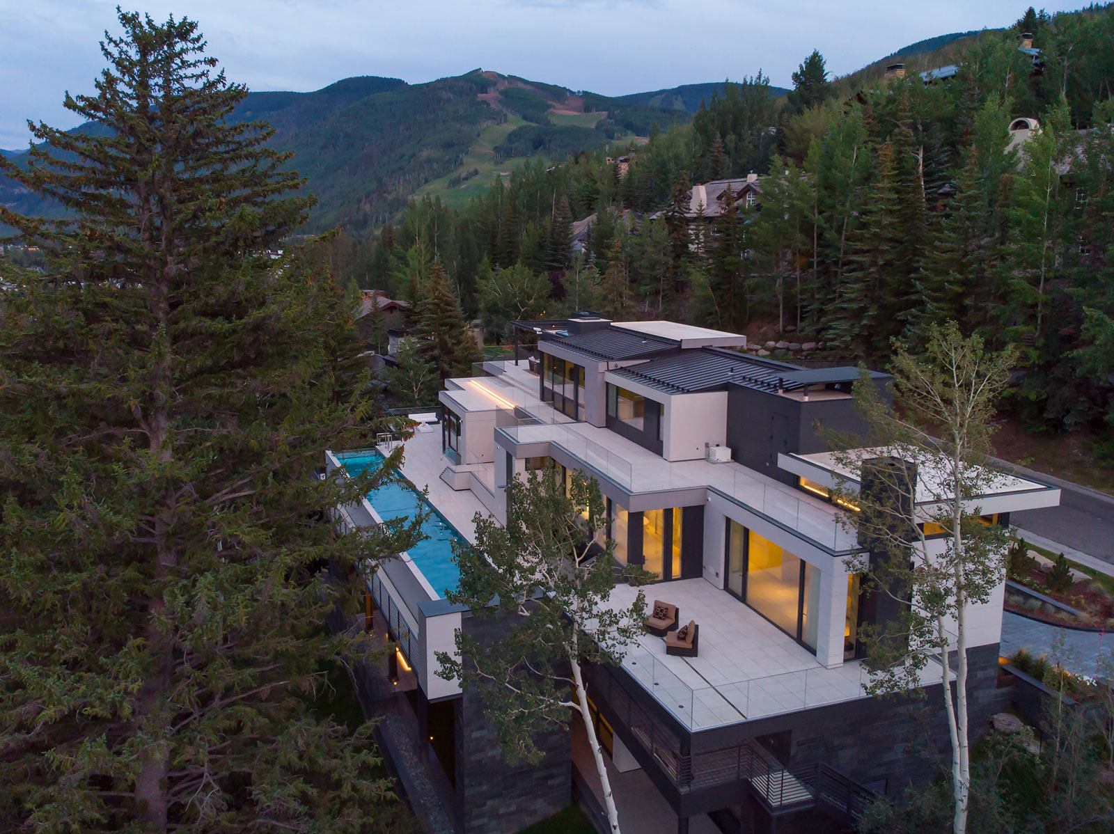 165 FOREST ROAD VAIL COLORADO MOUNTAIN REAR AERIAL SWIMMING POOL EXPANSIVE OUTDOOR LIVING SPACE